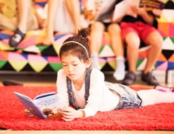 Girl reading at SIS Swiss International School