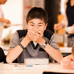 Boy laughing at SIS Swiss International School
