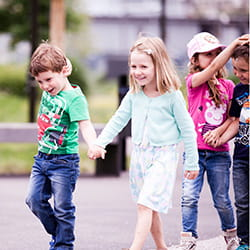 Children walking together at SIS Swiss International School