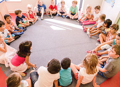 Children in a circle at SIS Swiss International School