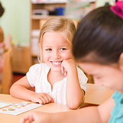 Smiling kindergarten girl at SIS Swiss International School